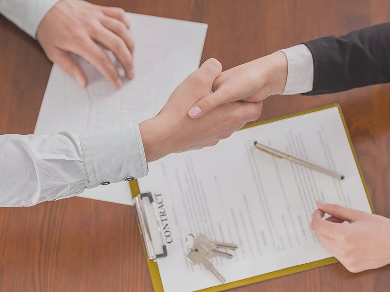 Shaking Hands Over Contracts
